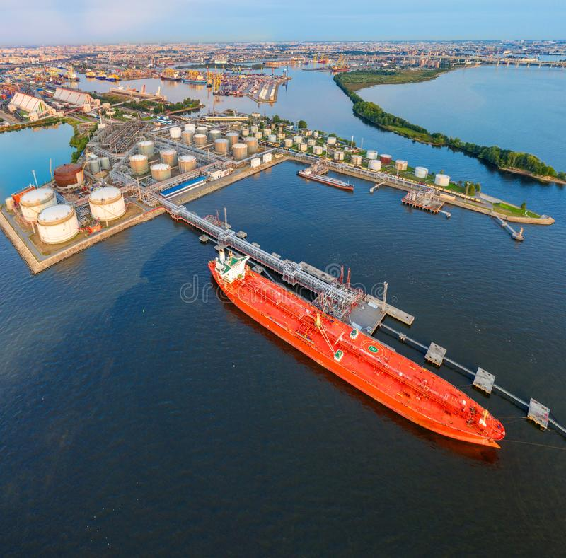 Aerial view large port with railway infrastructure for the delivery of bulk cargo by sea, loading oil using a pump station in ship. Tanker for transportation royalty free stock images
