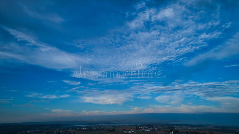 Late Afternoon Sun With Partly Cloudy Blue Sky Over Farm Countryside Background. Aerial View of a Late Afternoon Sun With Partly Cloudy Blue Sky Over Farm royalty free stock photography