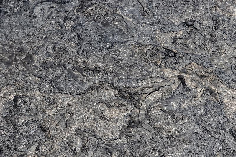 Aerial view of lava field; pahoehoe lava. Swirled texure and patterns, silver metallic color, cracks in surface. Aerial view of Puu Ooo Volcanic pahoehoe lava stock photos