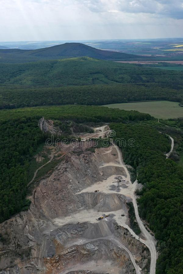 Aerial view of layers of upper part of open-cast stone quarry mine stock photography