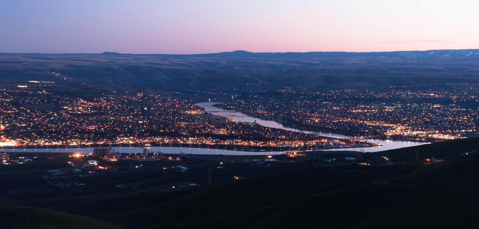 Aerial View Lewiston Idaho Bridge Bend Clearwater River Sunset. Dusk comes to Lewiston downtown and reflects its light in the Clearwater and Snake Rivers Idaho stock photography