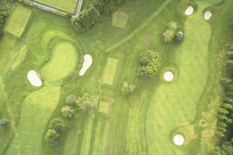 Aerial view of links golf course during summer showing green and bunkers at driving range. Uk royalty free stock image