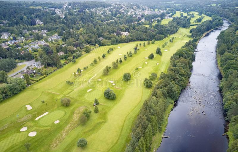 Aerial view of links golf course during summer showing green and bunkers at driving range. Uk royalty free stock photo
