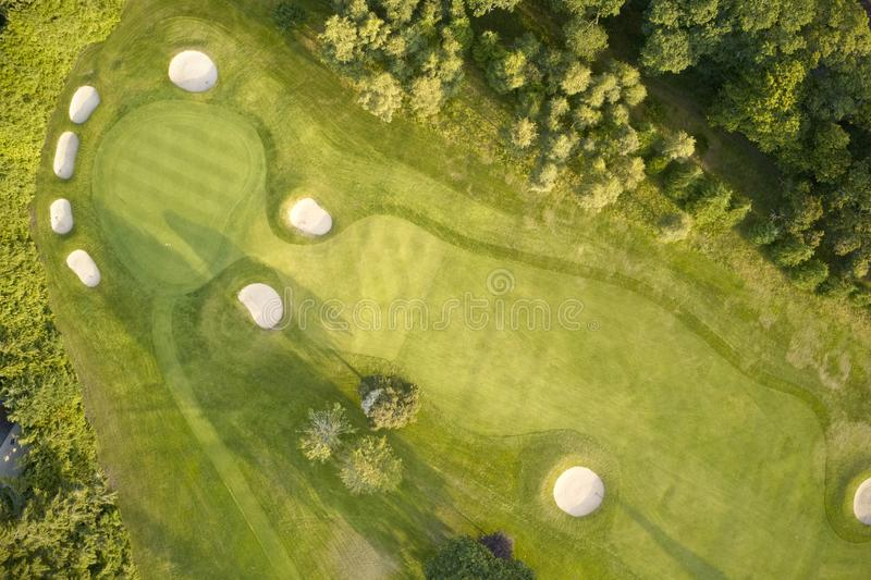 Aerial view of links golf course during summer showing green and bunkers at driving range. Uk stock images