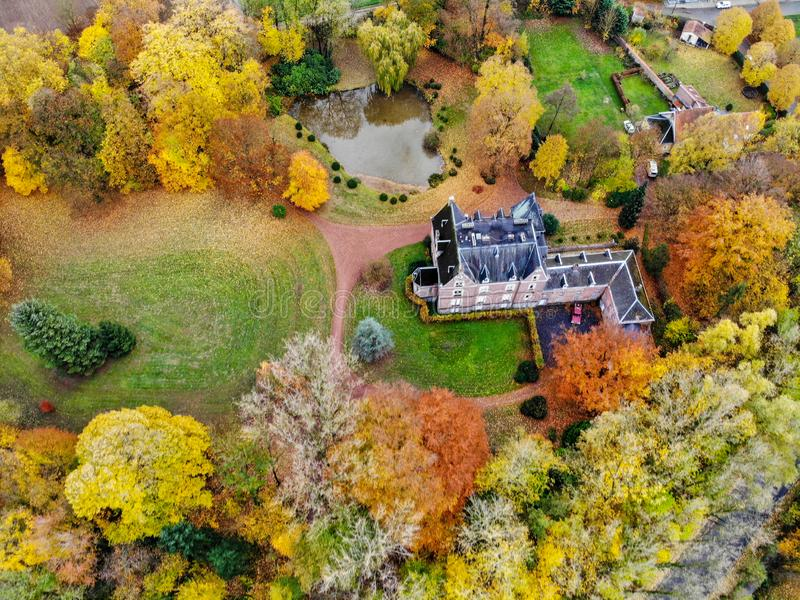 Aerial view of little castle surrounded by forest stock photos