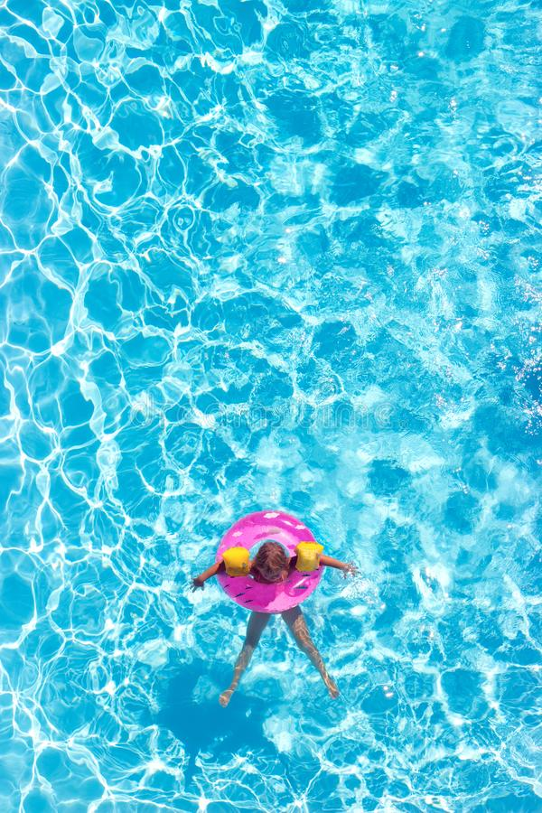 Aerial view of a little girl in the pool royalty free stock photo