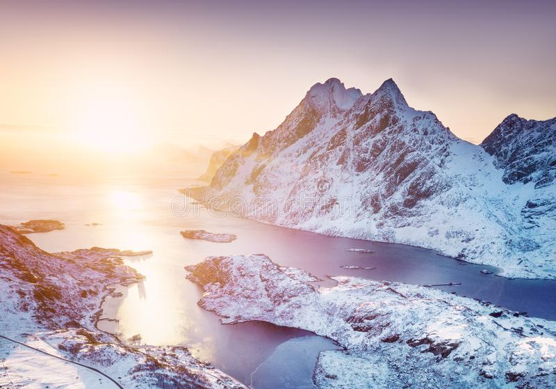 Aerial view at the Lofoten islands, Norway. Mountains and sea during sunset. Natural landscape from air at the drone. Norway at the winter time stock photography