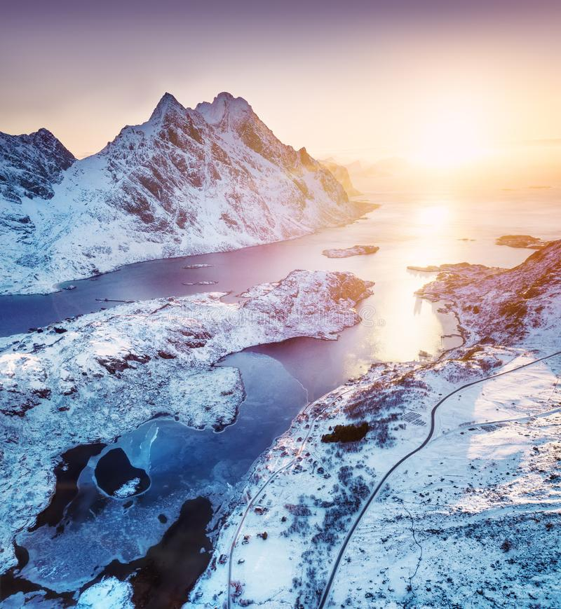 Aerial view at the Lofoten islands, Norway. Mountains and sea during sunset. Natural landscape from air at the drone. Norway at the winter time royalty free stock photos