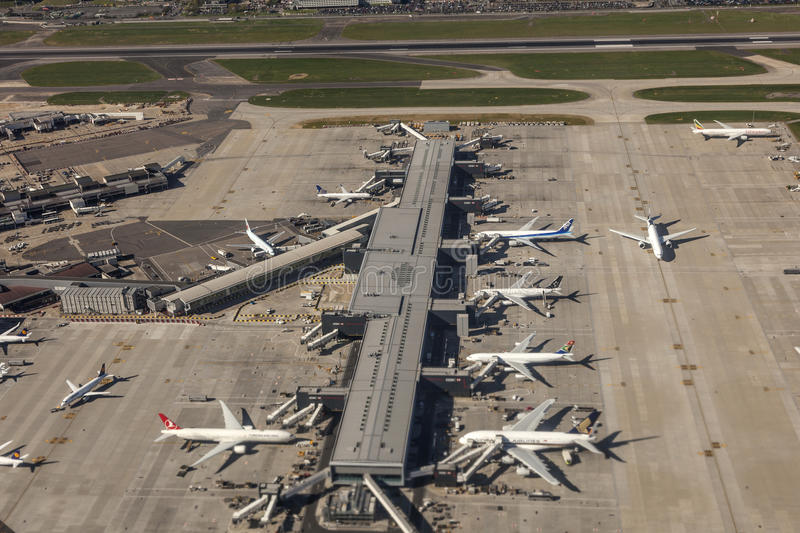 Aerial view of the London Heathrow Airport. LONDON, UK - APR 20, 2016: Aerial view of a terminal at the London Heathrow international airport. Hillingdon royalty free stock photography