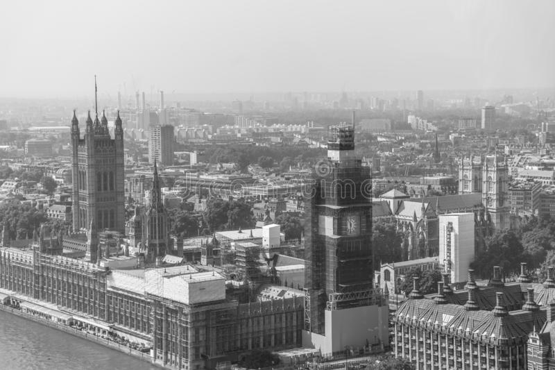 Aerial view of London with Westminster Bridge, Palace of Westminster and Big Ben being renovated in the distance. Black and White stock images