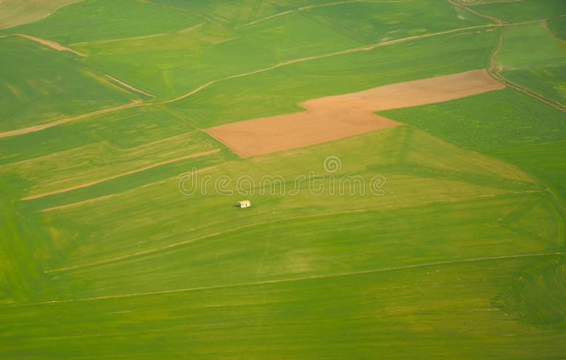 Aerial view of a lonely house among fields, agricultural parcels stock photos