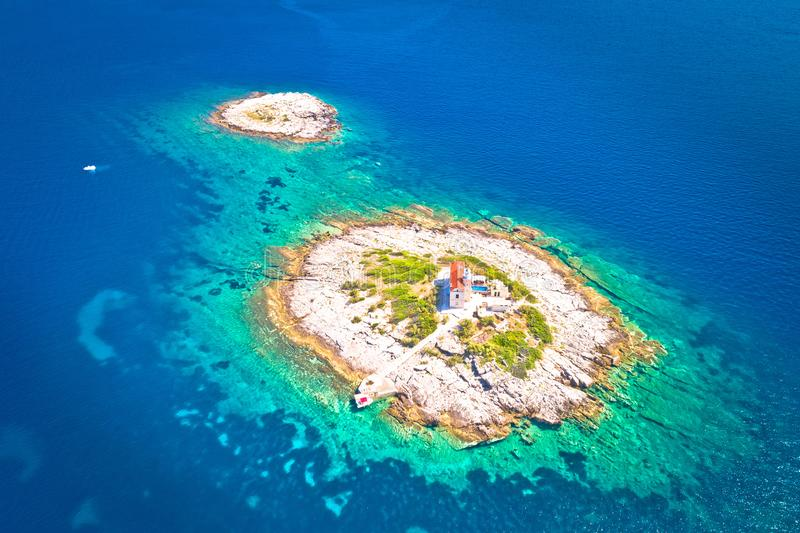 Aerial view of lonely island with lighthouse. Korcula riviera of Croatia, island Vela Sestrica royalty free stock images
