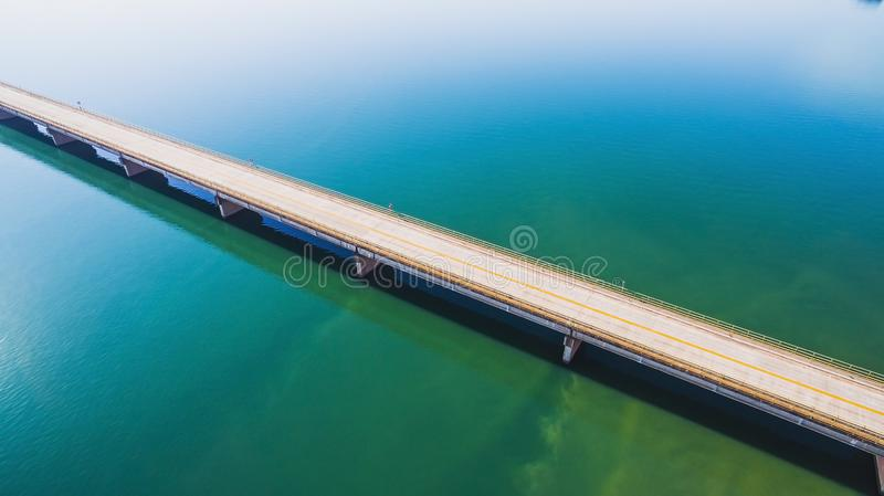 Aerial view of a long highway bridge above a river. royalty free stock image