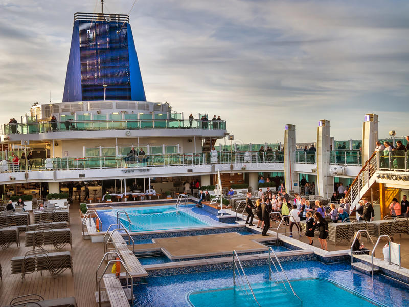 An aerial view of a luxury cruise ship pool area. An aerial view of a luxury cruise ship`s pool area on deck, during it`s twilight zone stock photography