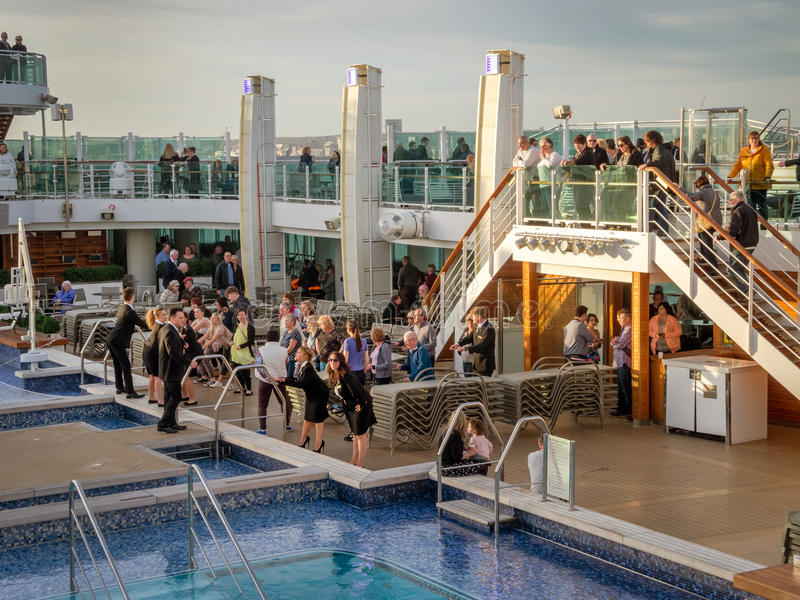 An aerial view of a luxury cruise ship pool area. An aerial view of a luxury cruise ship`s pool area on deck, during it`s twilight zone stock images