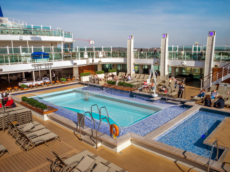 An aerial view of a luxury cruise ship pool area. An aerial view of a luxury cruise ship`s pool area on deck, during it`s twilight zone royalty free stock photos