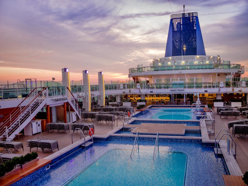 An aerial view of a luxury cruise ship pool area. An aerial view of a luxury cruise ship`s pool area on deck, during it`s twilight zone stock photos