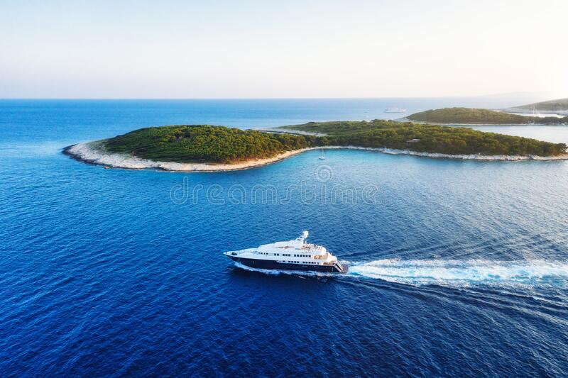 Aerial view on the luxury yacht at the day time. Adventure and travel. Landscape with ship on Adriatic sea. Luxury cruise. Aerial view on the luxury yacht at royalty free stock photos