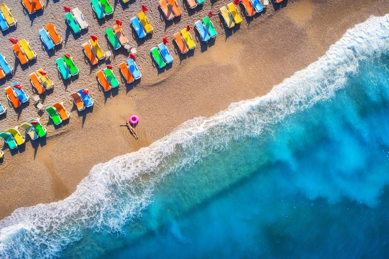 Aerial view of lying woman with swim ring in the sea in Oludeniz, Turkey. Summer scene royalty free stock photos