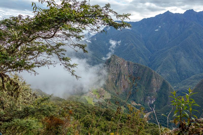 Aerial view of Machu Picchu Inca citadel in the clouds, located on a mountain ridge above the Sacred Valley royalty free stock image