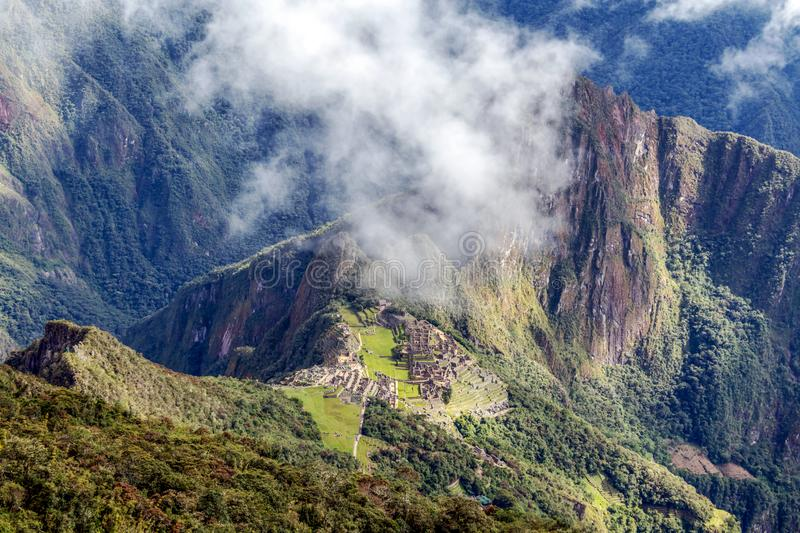 Aerial view of Machu Picchu Inca citadel in the clouds, located on a mountain ridge above the Sacred Valley. Aerial landscape background of Machu Picchu Inca royalty free stock photo