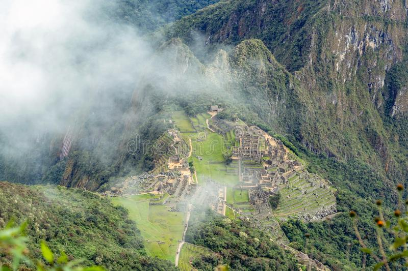 Aerial view of Machu Picchu Inca citadel ruins built in the classical Inca style, with polished dry-stone walls. Aerial landscape background of Machu Picchu Inca stock image