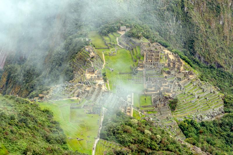 Aerial view of Machu Picchu Inca citadel ruins built in the classical Inca style, with polished dry-stone walls. Aerial landscape background of Machu Picchu Inca royalty free stock image