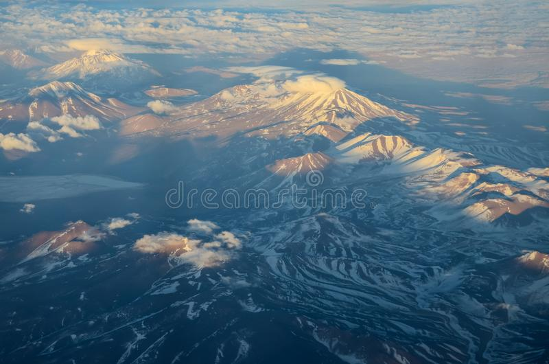 Aerial view of Magestuosa from large snowy mountains, with lake royalty free stock photos