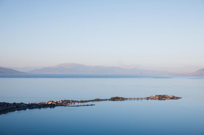 aerial view of majestic landscape with calm blue water and mountains in fog, royalty free stock images