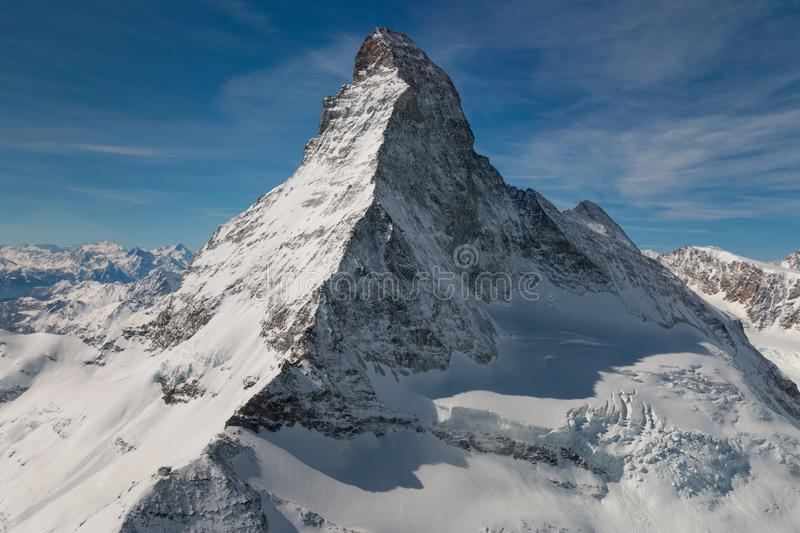 Aerial view of majestic Matterhorn mountain in front of a blue sky stock image