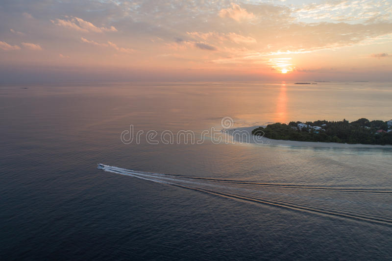 Aerial view on Maldivian island during the sunset. Aerial view on Maldivian island Ukulhas during the sunset stock images