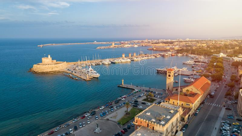 Aerial view of Mandraki port in Rhodes city. Beautiful panorama of the old city of Rhodes island at sunset, Greece. stock photos