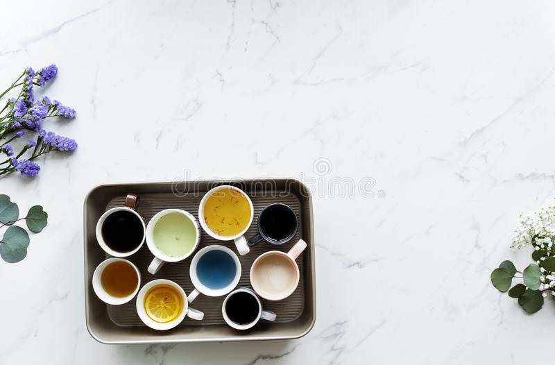 Aerial view of many different cups of beverages stock photography
