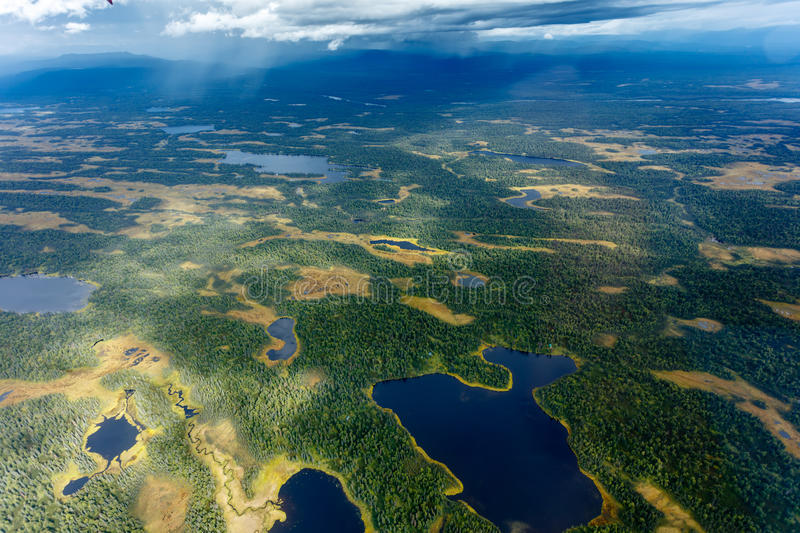 Aerial view many lakes and ponds within the taiga forest area of Alaska stock photos