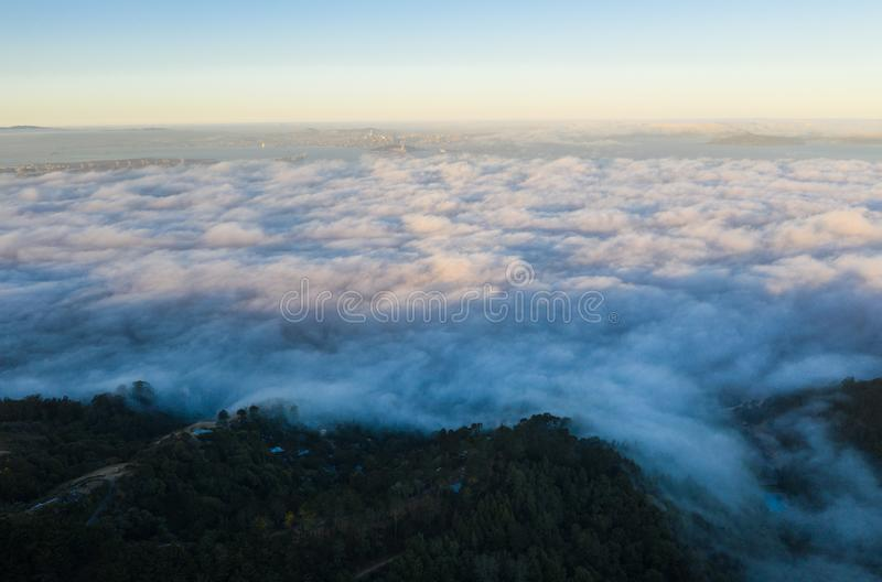 Aerial View of Marine Layer Drifting Over San Francisco Bay Area. The ever-present offshore marine layer in California is propelled inland in the San Francisco stock photography