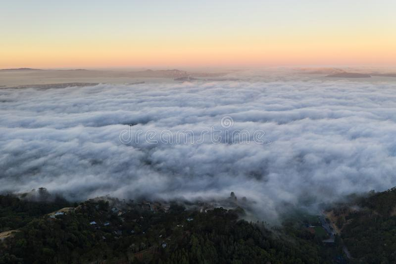 Aerial View of Marine Layer Flowing Over Bay Area. The ever-present offshore marine layer in California is propelled inland in the San Francisco Bay area by a royalty free stock photo