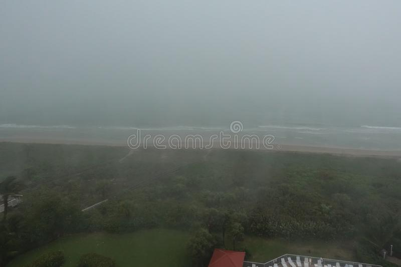 Aerial view of massive amounts of rain coming down at the beach royalty free stock photos
