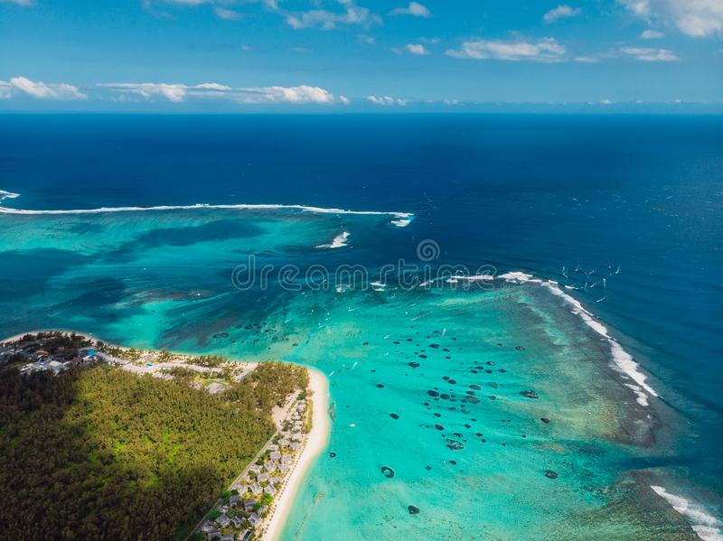 Aerial view of Mauritius island panorama and Le Morne Brabant mountain, lagoon and underwater waterfall stock images