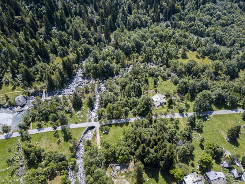 Aerial view of the Mello Valley, a valley surrounded by granite mountains and forest trees, renamed the little italian Yosemite stock photography