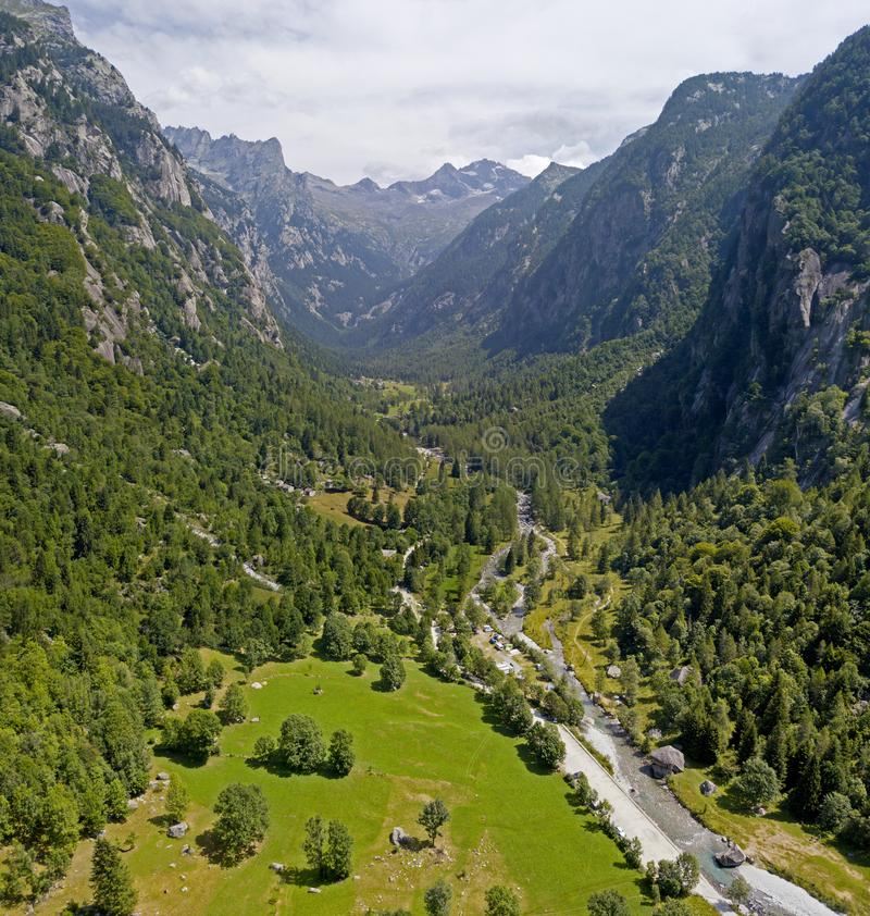 Aerial view of the Mello Valley, a valley surrounded by granite mountains and forest trees, renamed the little italian Yosemite stock photo