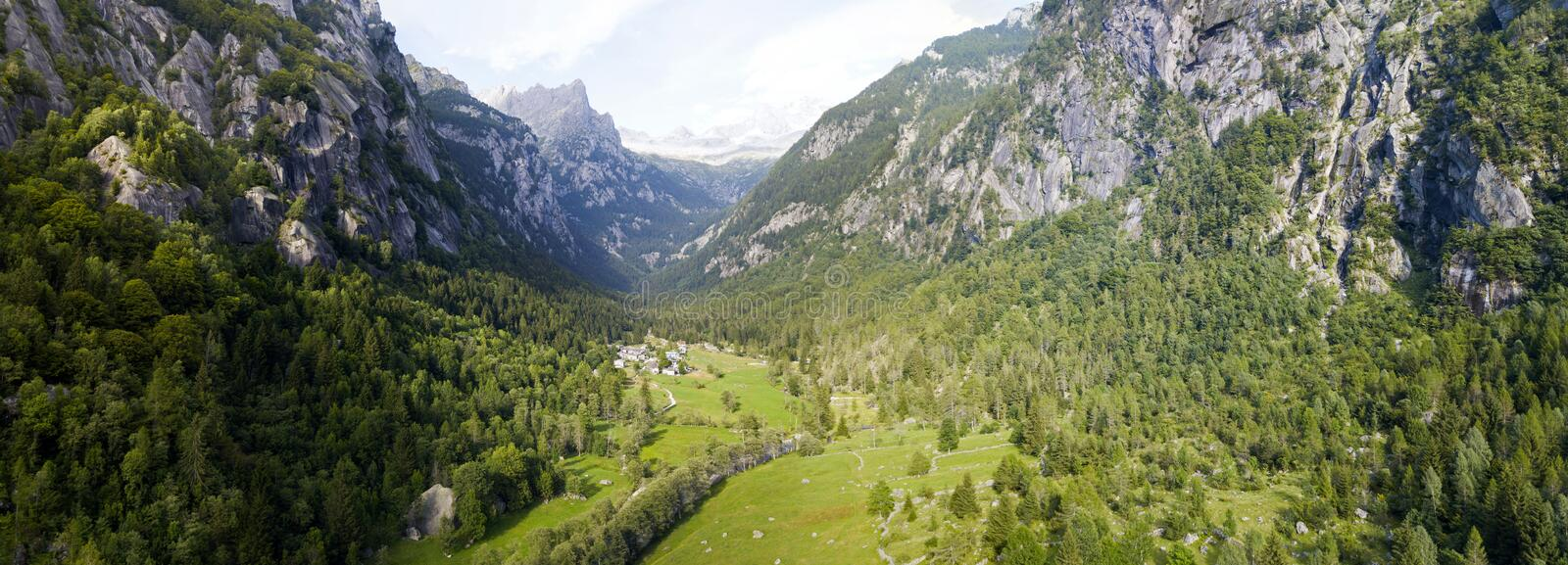 Aerial view of the Mello Valley, a valley surrounded by granite mountains and forest trees, renamed the little italian Yosemite stock photos