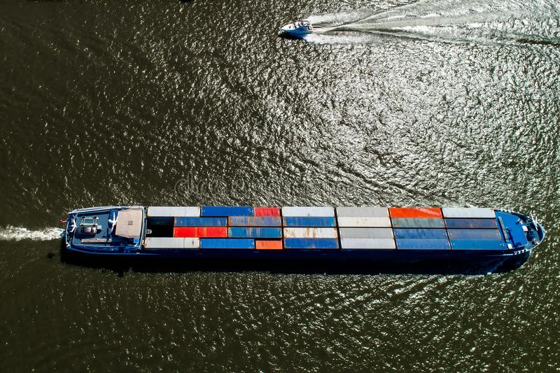 aerial view of a merchant ship with a container crossing the riv royalty free stock photos