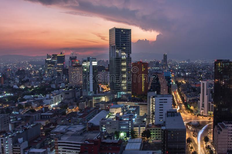 Aerial view of mexico city downtown skyscrappers at sunset time before night. royalty free stock photos