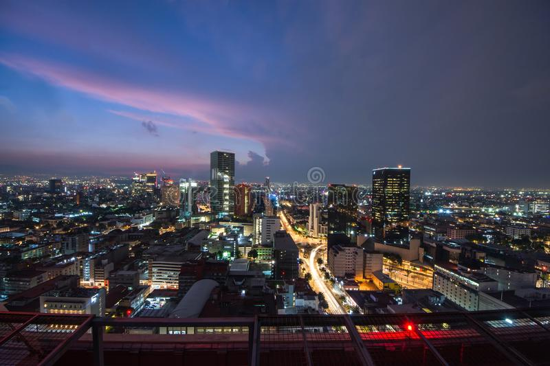 Aerial view of mexico city downtown skyscrappers at sunset time before night. stock image