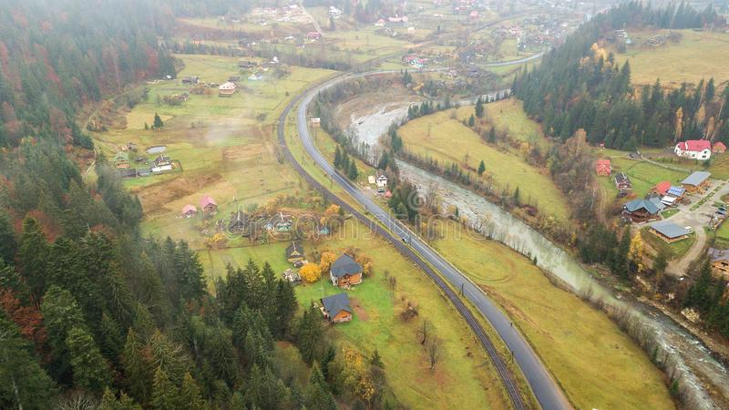 Aerial view of the middle of the mountains with road, railroad and river stock photography