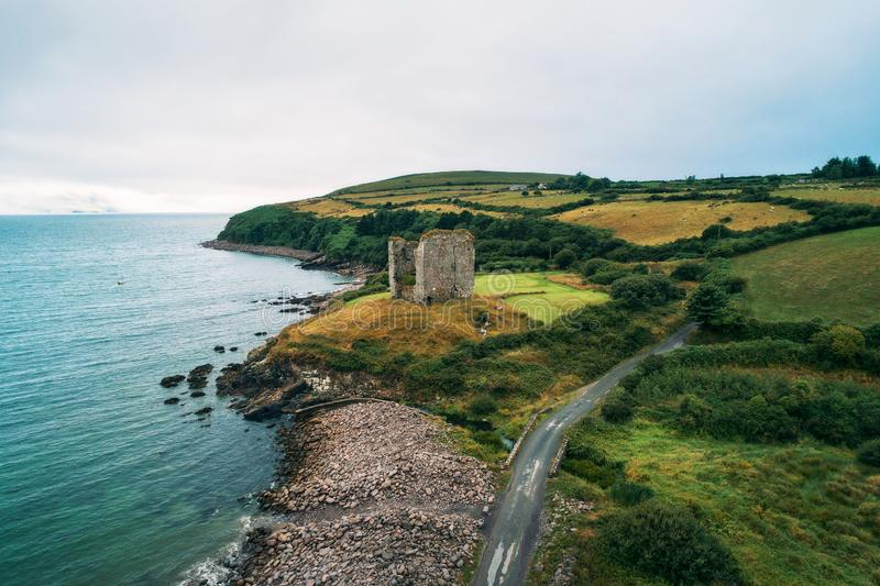 Aerial view of the Minard Castle situated on the Dingle Peninsula in Ireland. Aerial view of the Minard Castle situated on the rocky beach of the Dingle stock images