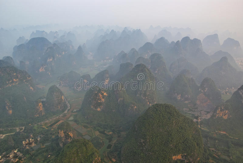 Aerial view of misty karst mountains in GuangXi. Province in China, near YangShuo, at dawn stock photo