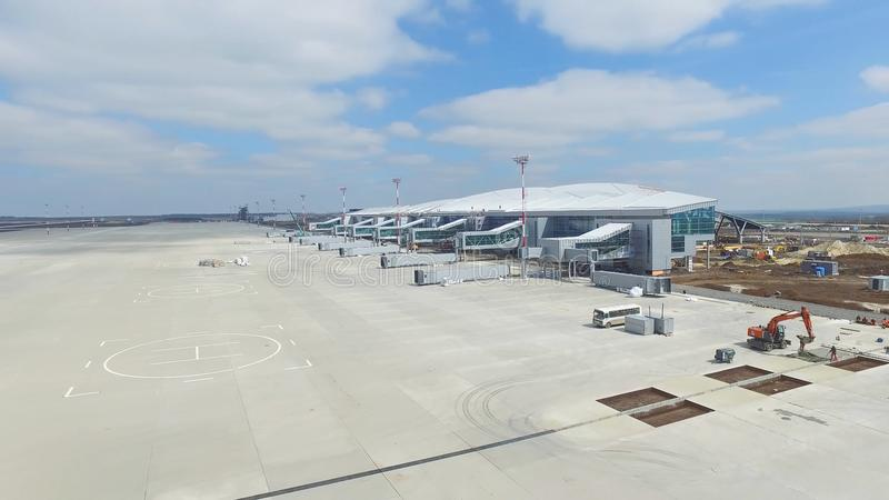 Aerial view of the modern international airport terminal. Traveling around the world. Empty airport aerial. View of royalty free stock image