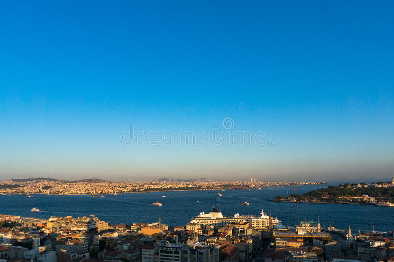Aerial view of modern Istanbul megalopolis cityscape. Aerial view of Istanbul, Turkey. Modern transcontinental megalopolis cityscape at golden hour royalty free stock photos