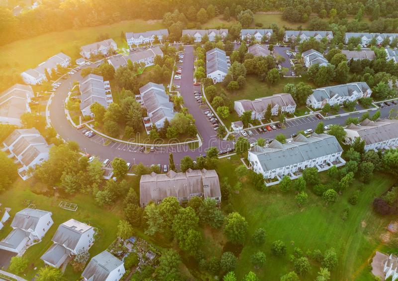 Aerial view of modern roofs of houses early sunrise stock image